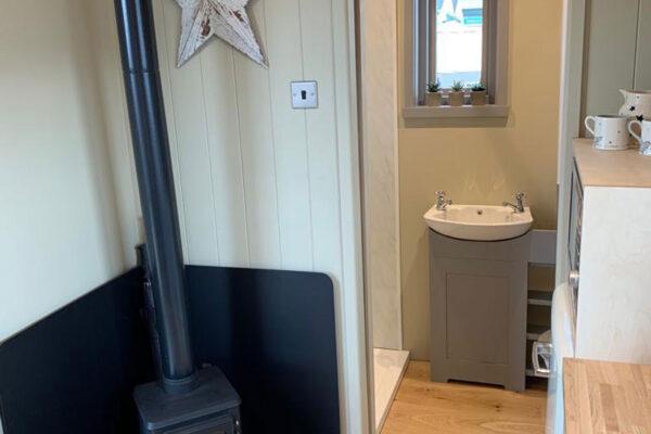 Shepherd Hut Stove and Bathroom